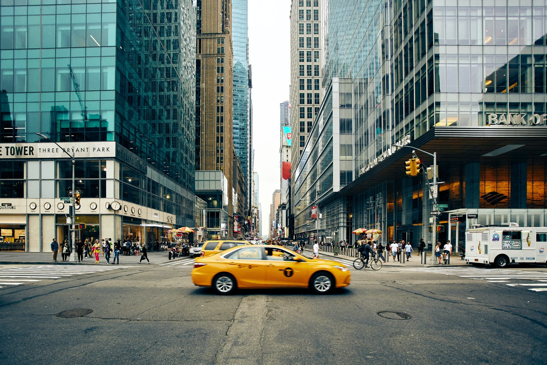 Yellow taxi at crossroads