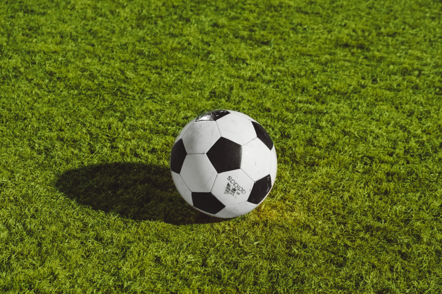 Football on green playing field