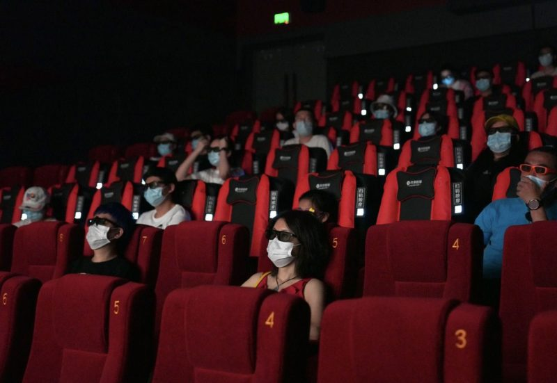 Cinemagoers wearing masks