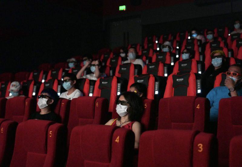 Cinemagoers wearing masks
