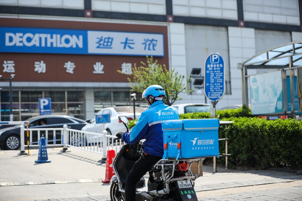 Delivery driver outside China Decathlon store