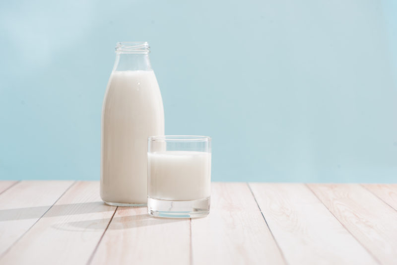 Glass of milk and milk bottle