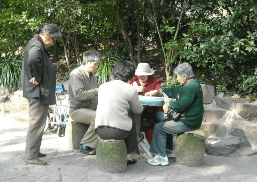 A group of Chinese elderly playing mahjong in Shanghai