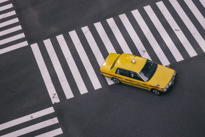Taxi at crossroads. Credit: Unsplash