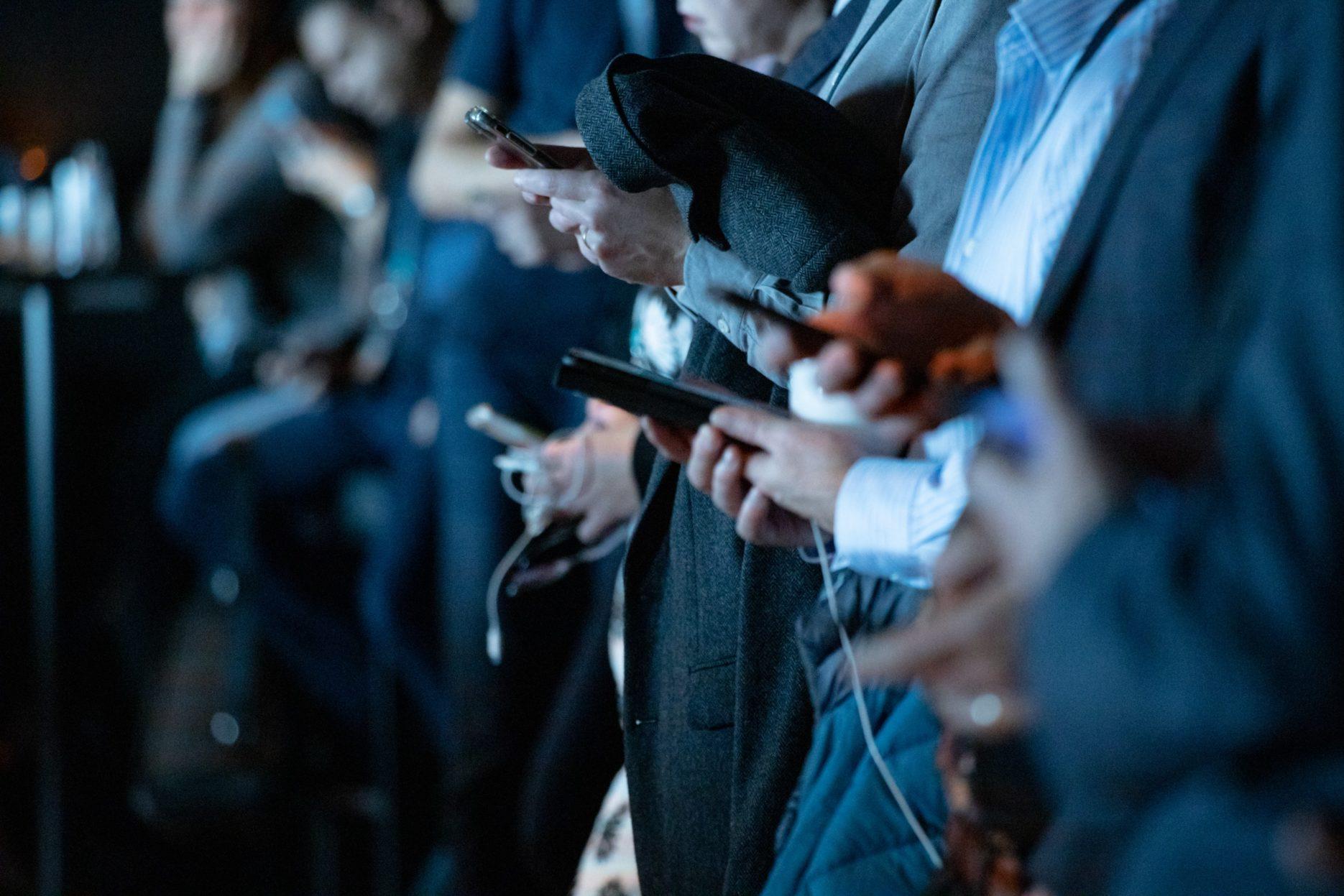 Users look at mobile phones. Credit: Unsplash